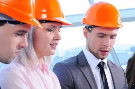 20706863-people-in-helmets-on-a-construction-site